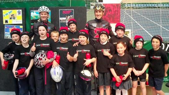 Greg Henderson & Hayden Roulston with local kids at ILT Velodrome 291010