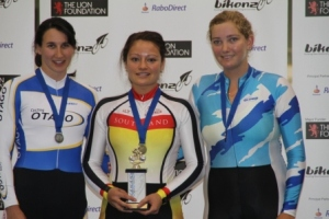 Natasha Hansen on the podium after winning the Womens 250m TT