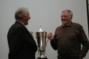 Graham Sycamore receives the Malayan Cup from Warwick Dalton - June 2011