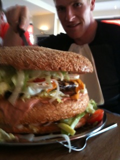 Matt Archibald takes on a giant Burger at XXL restaurant