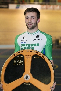 Tom Beadle with the Cycling Southland Wheelrace Trophy